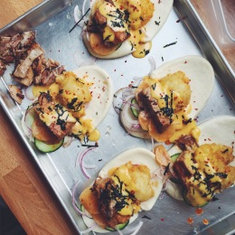 Pork belly steam bun with kimchi, hollandaise, seaweed, and panko-crusted crispy fried egg.