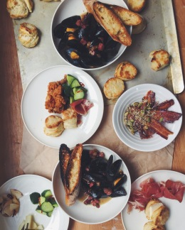 Southern cuisine with Japanese sensibilities. Pictured: tasso ham & mussels in white wine, butter / handmade biscuits / prosciutto / bacon & candied pumpkin seeds / japanese pickled tsukemono