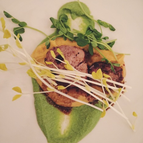 Heritage pork with root vegetable mash early pea soubise young pea tendrils